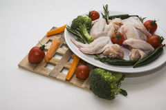 Wings and vegetables Stock Photography