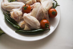 Wings and vegetables ready for cooking Stock Photos