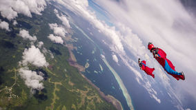 Wingsuit Diving Over Palau. A pair of wingsuiters enjoying the view over Koror, Palau Royalty Free Stock Photos