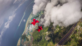 Wingsuit Flying In Koror, Palau. A pair of wingsuit flyers jump from an airplane over Palau Stock Image