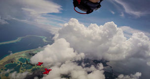 Wingsuit Flying Over Palau. A Pair of Wingsuit Flyers soaring over Palau Islands Stock Photography