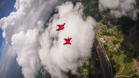 Wingsuit Flying Over Palau. A Pair of Wingsuit Flyers soaring over Palau Islands and the Pacific Ocean Royalty Free Stock Photo