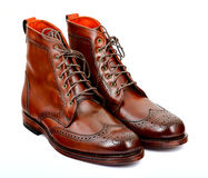 Wingtip dark chili dress boots isolated on white Royalty Free Stock Image