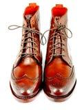 Wingtip dark chili dress boots isolated on white Stock Photo
