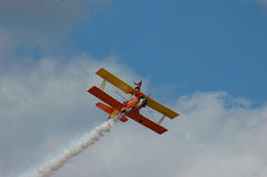 Wingwalker. A wingwalker stands and waves from the upper wing of a Grumman Showcat stock images