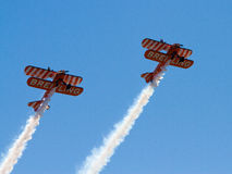 Wingwalkers on biplane Stock Image