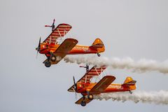 Wingwalkers at Duxford Airshow 2019. Wingwalkers going through their routine aboard Boeing Stearman biplanes at a UK airshow royalty free stock photo