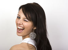Wink. A big wink from a gorgeous young woman Royalty Free Stock Photo
