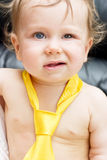 Wink. Portrait of a baby boy in a tie Royalty Free Stock Images