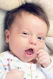Wink baby. Little baby wink and smile Royalty Free Stock Image