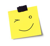 Wink face on adhesive note Stock Image