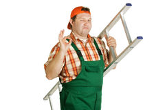 Wink working. With a ladder in the hands of Royalty Free Stock Photography