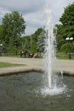 Winkel des städtischen allgemeinen Gartens mit einem Brunnen und Pferden im Ba Stockbilder