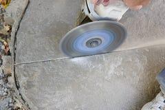 Winkel-Schleifer Scoring Concrete Stockbild