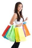 Winkelend Aziatisch meisje Stock Foto's