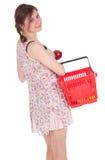 Winkelend meisje met appel Stock Foto's