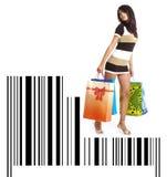Winkelend meisje met zak op streepjescode Royalty-vrije Stock Fotografie