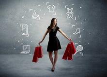 Winkelend wijfje met zakken en getrokken pictogrammen Stock Afbeelding