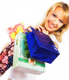Winkelende blonde vrouw over een witte achtergrond Royalty-vrije Stock Fotografie
