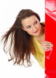 Winkelende mooie vrouw over witte achtergrond Royalty-vrije Stock Foto's