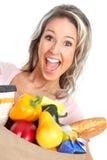 Winkelende vrouw met een zak voedsel Royalty-vrije Stock Afbeeldingen