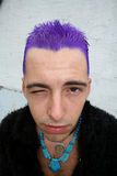 Winking. Punk with purple hair Royalty Free Stock Photo