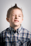 Winking boy royalty free stock photography