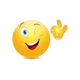 Winking emoticon showing ok sign Royalty Free Stock Image