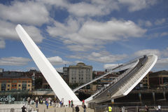 Winking Eye Bridge. The Millennium Bridge that spans the River Tyne between Gateshead and Newcastle, England.  As shown here, it can tilt to allow large vessels Royalty Free Stock Photos