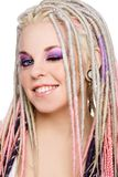 Winking girl. Portrait of young beautiful happy smiling girl with stylish make-up and dreads Royalty Free Stock Image