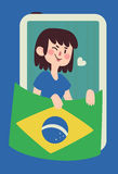 Winking Girl Holding a Brazilian Flag Royalty Free Stock Photo