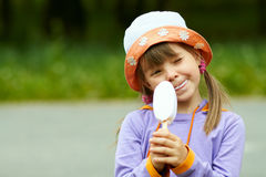 Winking girl with ice cream Royalty Free Stock Photo
