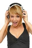 Winking girl listening music Stock Images