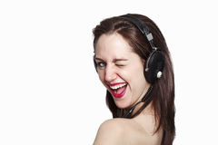 Winking girl listening to music Stock Image