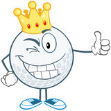 Winking Golf Ball With Gold Crown Holding A Thumb  Royalty Free Stock Photo