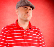 Winking man. Man winking on the red background Stock Photos