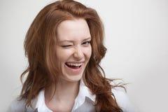 winking Ragazza che sbatte le palpebre nella macchina fotografica Immagine Stock