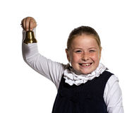 Winking school girl ringing a golden bell. Winking Young school girl ringing a golden bell on white background Stock Image