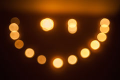 Winking smiley of the candles on dark Royalty Free Stock Image