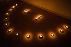 Winking smiley of the candles on dark Stock Image