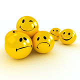 Winking smiley carried by sad and angry ones Royalty Free Stock Photos