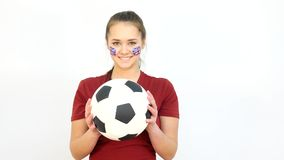 Winking Soccer British Fan Catching Ball stock footage