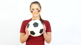 Winking Soccer German Fan Catching Ball stock footage