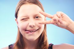 Winking teen girl Stock Photos