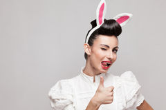 Winking and thumbs up. Sexy pin up style bunny girl Royalty Free Stock Photography