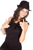 Winking Woman. Upper body shot of woman in a black dress winking her eye and making hand gun gestures royalty free stock photos