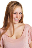 Winking woman with long blond hair Royalty Free Stock Photo