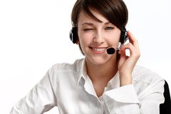 Winking woman operator with headset. Microphone and headphones, on white stock image