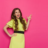 Winking Woman Shouting And Pointing Royalty Free Stock Photo