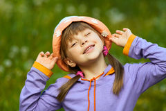 Winks at the girl in a hat Stock Image